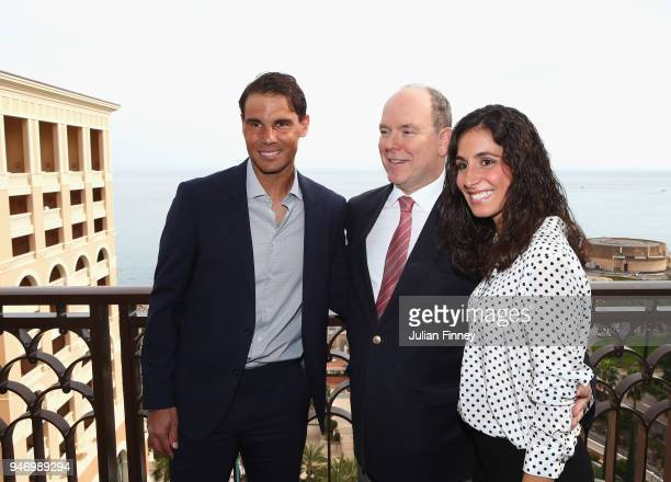 Rafael Nadal of Spain poses on his balcony with his girlfriend Maria Francisca Perello and Albert II Prince of Monaco during Day Two of the ATP...