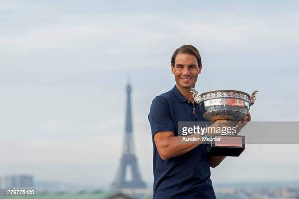 Rafael Nadal of Spain poses on the roof of Les Galeries Lafayette with Les Mousquetaires trophy following his victory in the Men's Singles Finals...