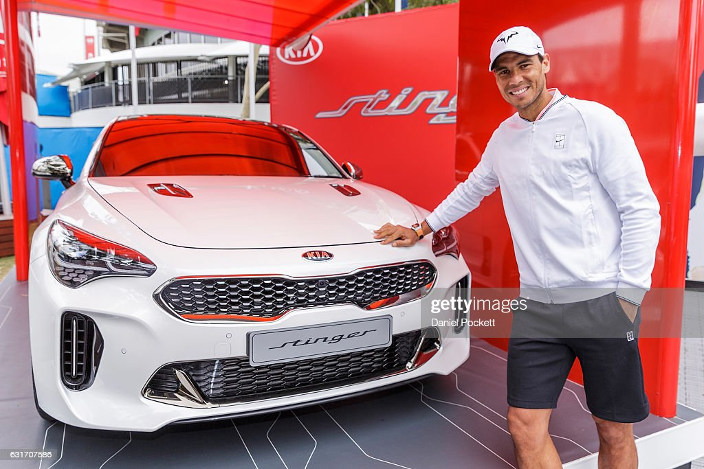 Rafael Nadal of Spain poses with a KIA Stinger during a Kia Key handover ceremony at Garden Square in Melbourne Park January 15, 2017 in Melbourne, Australia.
