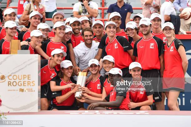 Rafael Nadal of Spain poses with ball boys and ball girls after his victory against Daniil Medvedev of Russia during the mens singles final on day 10...