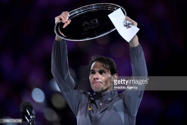 Rafael Nadal of Spain poses with his runner up trophy following defeat in his Men's Singles Final match against Novak Djokovic of Serbia on the day...