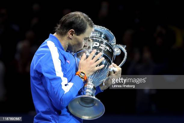Rafael Nadal of Spain poses with his trophy after being announced as ATP Tour end of year world number one following his singles match against...