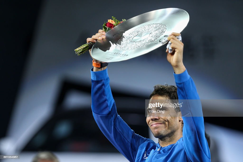 Rafael Nadal of Spain poses with runner-up trophy during the award ceremony after losing his Men's singles final match against Roger Federer of Switzerland on day 8 of 2017 ATP Shanghai Rolex Masters at Qizhong Stadium on October 15, 2017 in Shanghai, China.