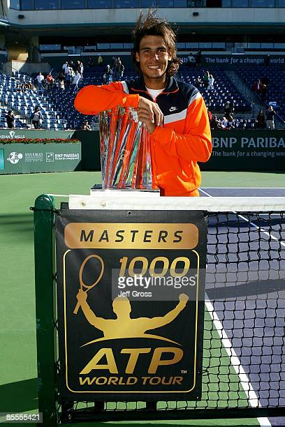 Rafael Nadal of Spain poses with the championship trophy after defeating Andy Murray of Great Britain in the final of the BNP Paribas Open on March...