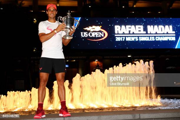 Rafael Nadal of Spain poses with the championship trophy after he defeated Kevin Anderson of South Africa in the Men's Singles Finals match on Day...