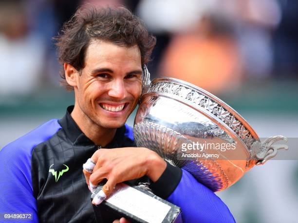 Rafael Nadal of Spain poses with the championship trophy after winning his French Open final match against Stan Wawrinka of Switzerland at the Roland...