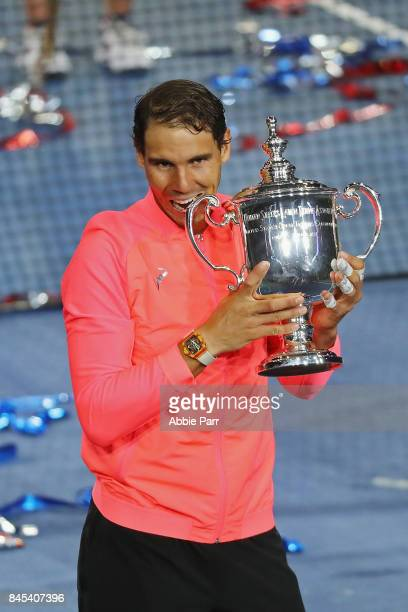 Rafael Nadal of Spain poses with the championship trophy during the trophy ceremony after he defeated Kevin Anderson of South Africa in the Men's...