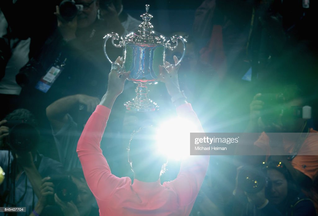 Rafael Nadal of Spain poses with the championship trophy during the trophy ceremony after he defeated Kevin Anderson of South Africa in the Men's Singles Finals match on Day Fourteen of the 2017 US Open at the USTA Billie Jean King National Tennis Center on September 10, 2017 in the Flushing neighborhood of the Queens borough of New York City. Rafael Nadal defeated Kevin Anderson in the third set with a score of 6-3, 6-3, 6-4.