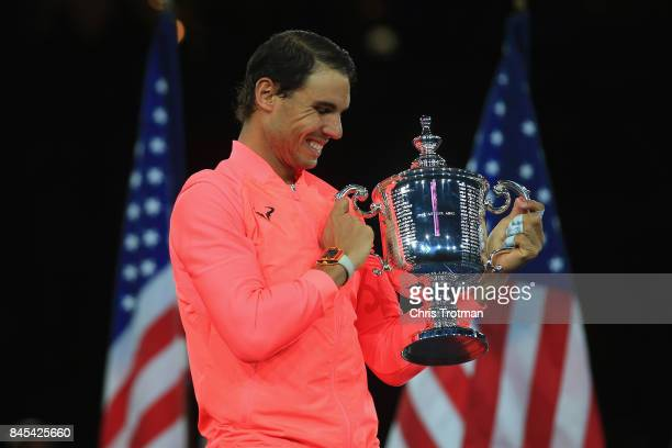Rafael Nadal of Spain poses with the championship trophy during the trophy ceremony after defeating Kevin Anderson of South Africa during their Men's...