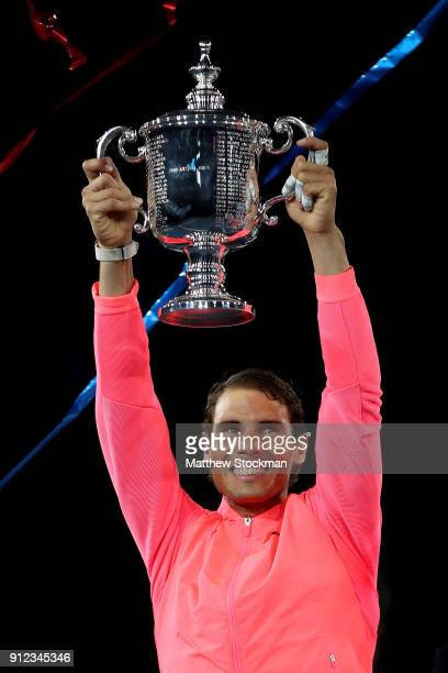 Rafael Nadal of Spain poses with the championship trophy during the trophy ceremony after their Men's Singles Finals match on Day Fourteen of the...