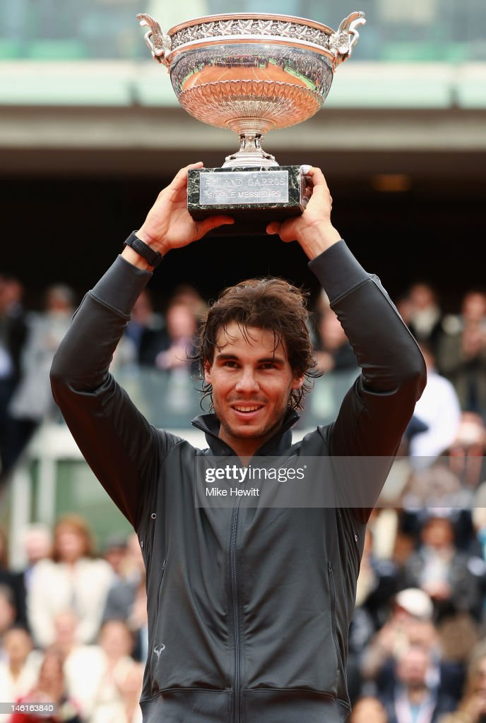 Rafael Nadal of Spain poses with the Coupe des Mousquetaires trophy in the men's singles final against Novak Djokovic of Serbia during day 16 of the French Open at Roland Garros on June 11, 2012 in Paris, France.