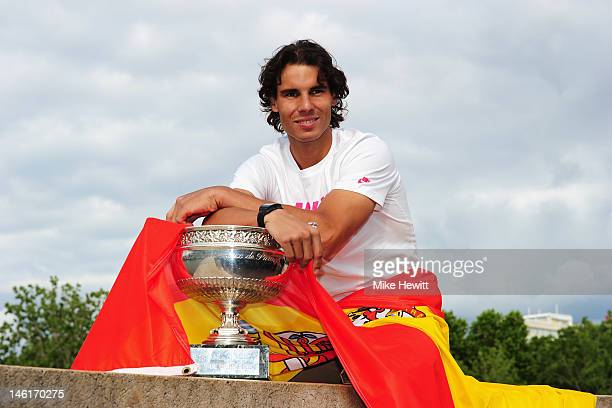 Rafael Nadal of Spain poses with the Coupe des Mousquetaires trophy after his victory against Novak Djokovic of Serbia during day 16 of the French...