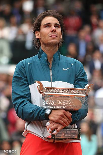 Rafael Nadal of Spain poses with the Coupe des Mousquetaires trophy as he celebrates victory in the men's singles final against David Ferrer of Spain...