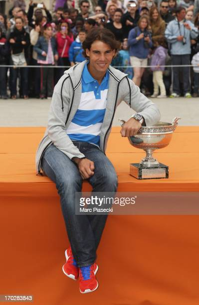 Rafael Nadal of Spain poses with the Coupe des Mousquetaires trophy as he celebrates his eighth French Open title at Disneyland Resort Paris on June...