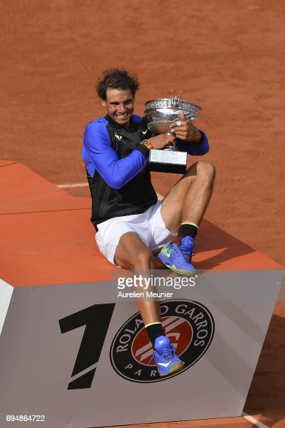 Rafael Nadal of Spain poses with the Mousquetaires Trophy after winning the men's single final match against Stan Wawrinka of Switzerland on day...
