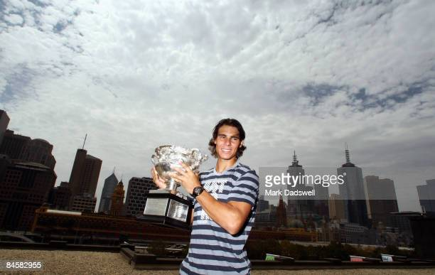 Rafael Nadal of Spain poses with the Norman Brookes Challenge Cup at the Langham Hotel following his victory in the Men's Singles Final at the 2009...