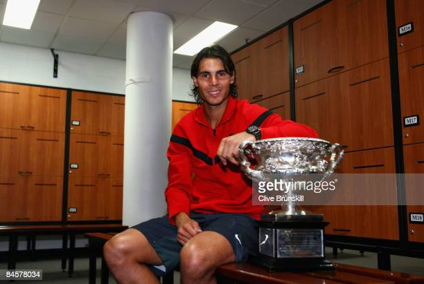 Rafael Nadal of Spain poses with the Norman Brookes Challenge Cup in the players locker room after winning the men's final match against Roger...