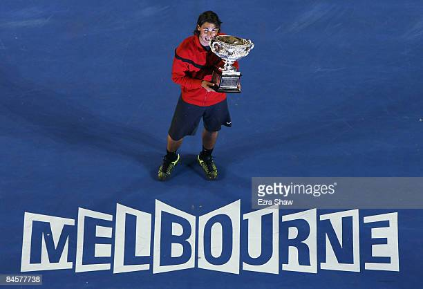 Rafael Nadal of Spain poses with the Norman Brookes Challenge Cup after winning his men's final match against Roger Federer of Switzerland during day...