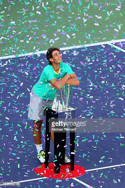 Rafael Nadal of Spain poses with the trophy after defeating Juan Martin Del Potro of Argentina to win the men's final match of the 2013 BNP Paribas...