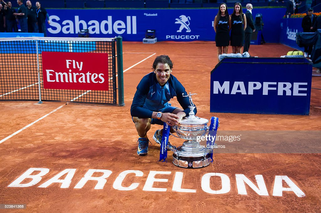 Rafael Nadal of Spain poses with the trophy after defeating Kei Nishikori of Japan in the final match during day seven of the Barcelona Open Banc Sabadell at the Real Club de Tenis Barcelona on April 24, 2016 in Barcelona, Spain.