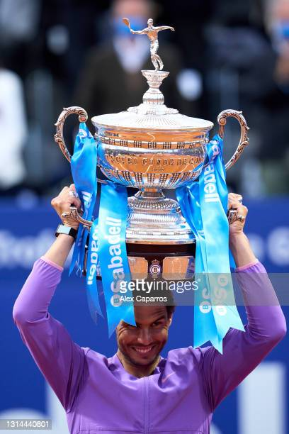 Rafael Nadal of Spain poses with the trophy after his victory against Stefanos Tsitsipas of Greece in their final match during day seven of the...