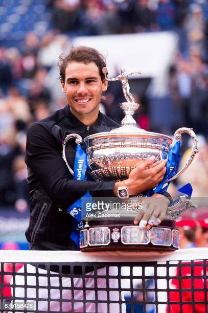 Rafael Nadal of Spain poses with the trophy after his victory against Dominic Thiem of Austria in their final match on day seven of the Barcelona...