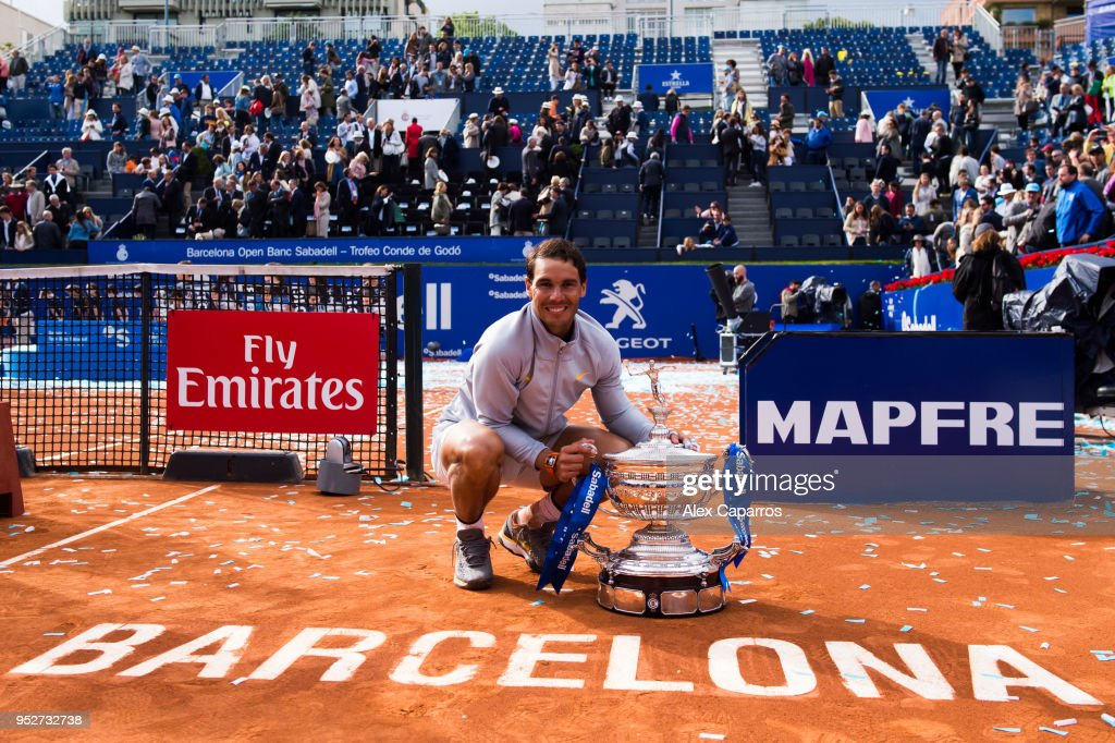 Rafael Nadal of Spain poses with the trophy after his victory against Stefanos Tsitsipas of Greece in their final match during day seven of the Barcelona Open Banc Sabadell on April 29, 2018 in Barcelona, Spain.