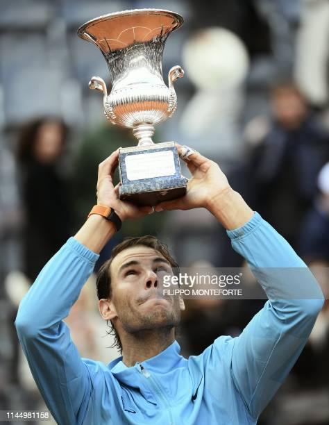 Rafael Nadal of Spain poses with the trophy after winning against Novak Djokovic of Serbia during their ATP Masters tournament final tennis match at...
