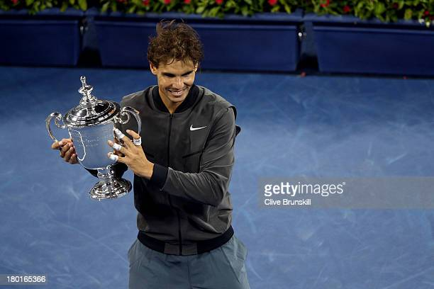 Rafael Nadal of Spain poses with the US Open Championship trophy as he celebrates winning the men's singles final match against Novak Djokovic of...