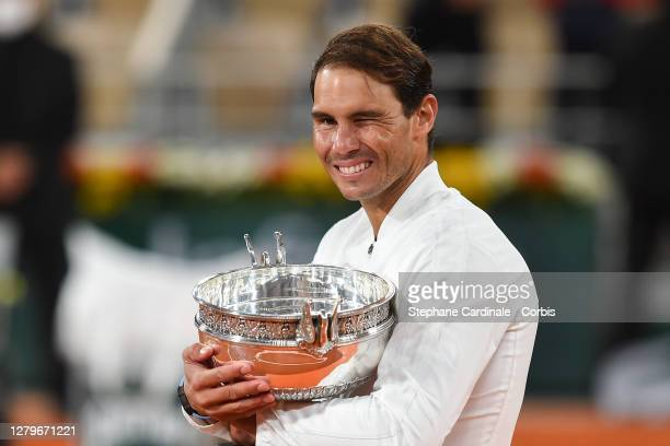 Rafael Nadal of Spain poses with the winners trophy after his victory against Novak Djokovic of Serbia in the Singles Final on Court...