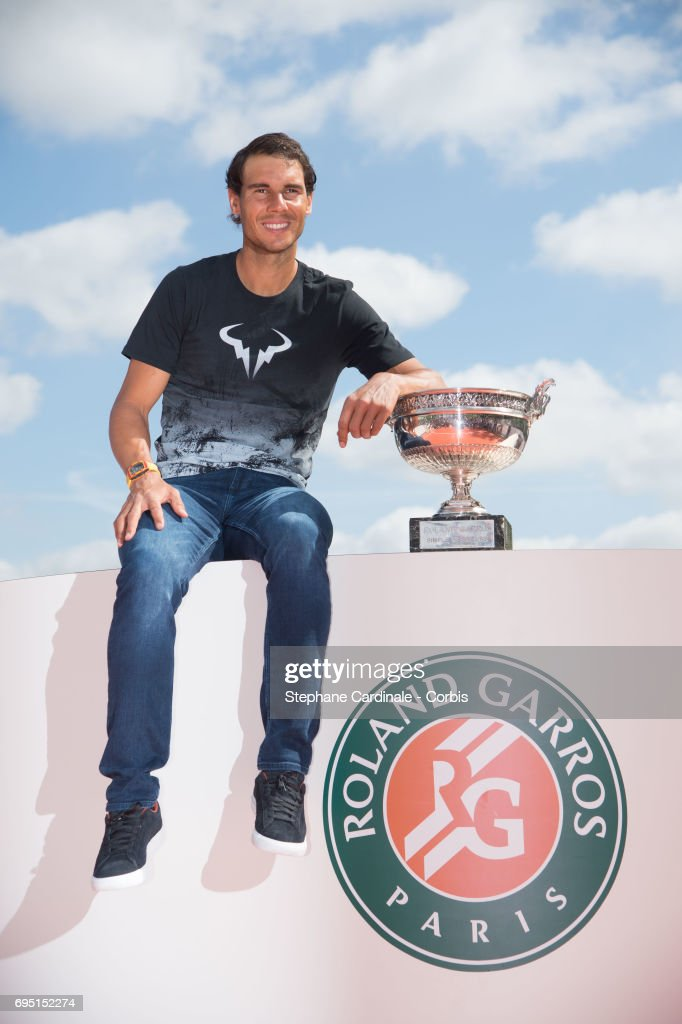 Rafael Nadal of Spain poses with the winner's trophy during a photocall to celebrate his record breaking 10th French Open title on the Seine River on June 12, 2017 in Paris, France.