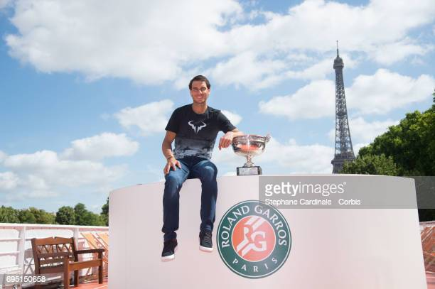 Rafael Nadal of Spain poses with the winner's trophy next to the Eiffel Tower during a photocall to celebrate his record breaking 10th French Open...