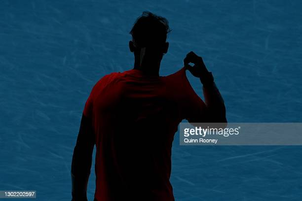 Rafael Nadal of Spain prepares to return serve in his Men's Singles fourth round match against Fabio Fognini of Italy during day eight of the 2021...