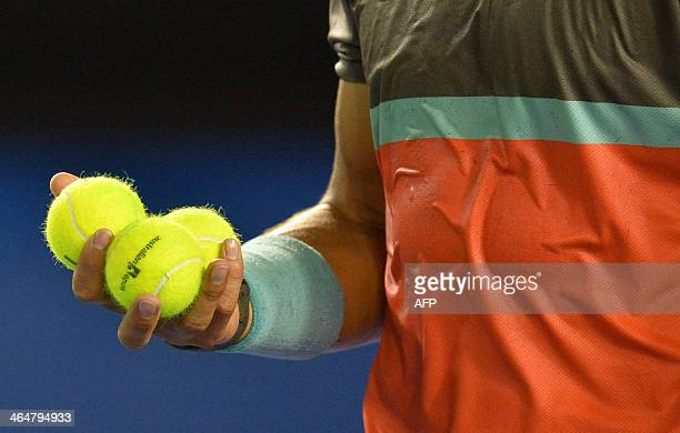 Rafael Nadal of Spain prepares to serve against Roger Federer of Switzerland during their men's singles semifinal match on day 12 of the 2014...