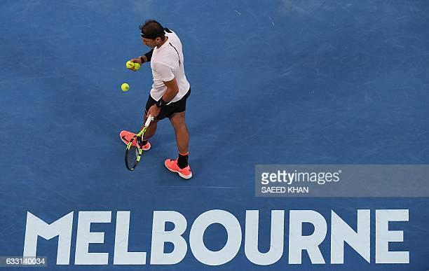 Rafael Nadal of Spain prepares to serve against Roger Federer of Switzerland during the men's singles final on day 14 of the Australian Open tennis...