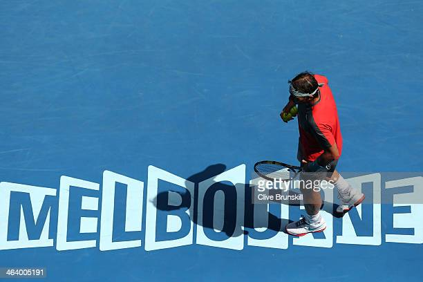 Rafael Nadal of Spain prepares to serve in his fourth round match against Kei Nishikori of Japan during day eight of the 2014 Australian Open at...