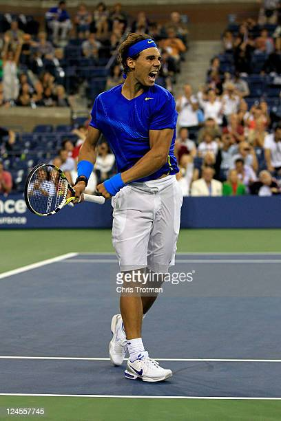 Rafael Nadal of Spain reacts after he won his match point against Andy Murray of Great Britain during Day Thirteen of the 2011 US Open at the USTA...