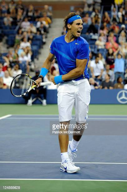 Rafael Nadal of Spain reacts after he won match point against Andy Murray of Great Britain during Day Thirteen of the 2011 US Open at the USTA Billie...