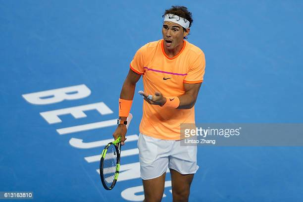 Rafael Nadal of Spain reacts after losing the point against Grigor Dimitrov of Bulgaria during the Men's Singles Quarterfinals match on day seven of...