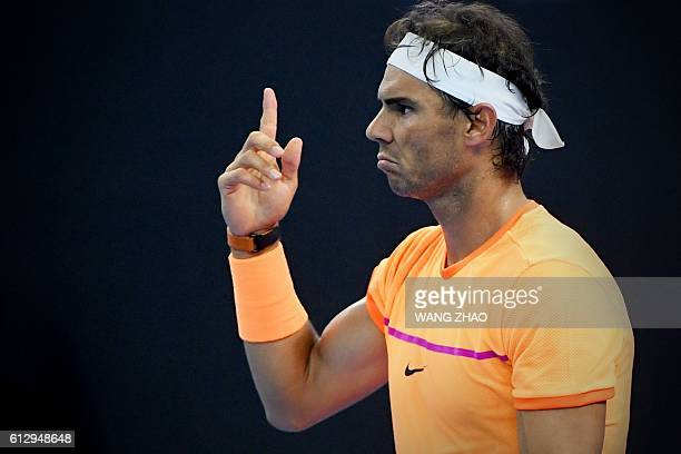 Rafael Nadal of Spain reacts after winning a point against Adrian Mannarino of France during their second round men's singles match at the China Open...