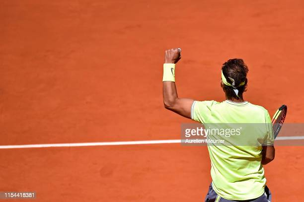 Rafael Nadal of Spain reacts after winning his mens singles semifinal match against Roger Federer of Switzerland during Day thirteen of the 2019...