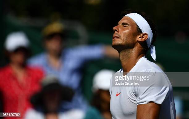 Rafael Nadal of Spain reacts against Lucas Pouille of France during the Aspall Tennis Classic at Hurlingham on June 29 2018 in London England