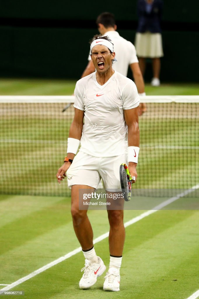 Rafael Nadal of Spain reacts as he loses the third set during his Men's Singles semi-final match against Novak Djokovic of Serbia on day eleven of the Wimbledon Lawn Tennis Championships at All England Lawn Tennis and Croquet Club on July 13, 2018 in London, England.