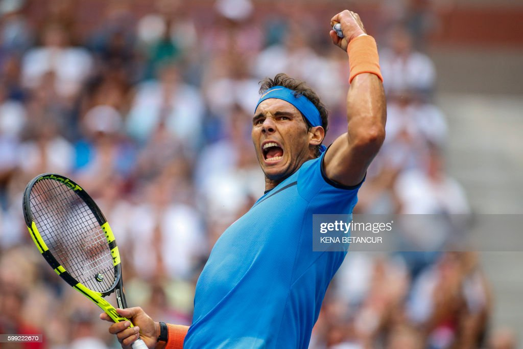 TOPSHOT - Rafael Nadal of Spain reacts as he plays against Lucas Pouille of France during their US Open Men's Singles match at the USTA Billie Jean King National Tennis Center in New York on September 4, 2016. /