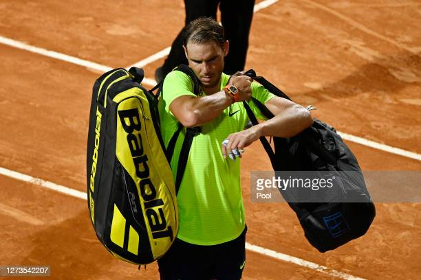 Rafael Nadal of Spain reacts as he walks off the court after defeat in his quarterfinal match against Diego Schwartzman of Argentina during day six...