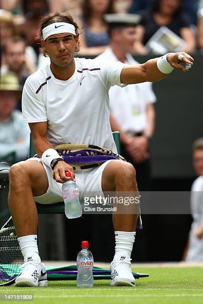 Rafael Nadal of Spain reacts during a break during his Gentlemen's Singles first round match against Thomaz Bellucci of Brazil on day two of the...