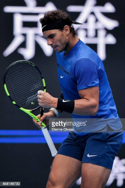 Rafael Nadal of Spain reacts during his Men's singles quarterfinal match against John Isner of the United States on day seven of the 2017 China Open...