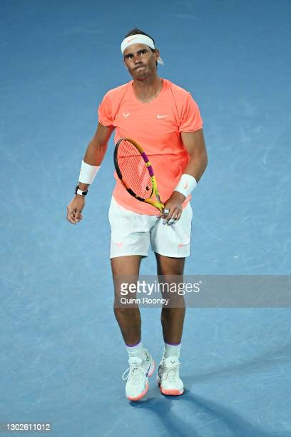 Rafael Nadal of Spain reacts during his Men's Singles Quarterfinals match against Stefanos Tsitsipas of Greece during day 10 of the 2021 Australian...