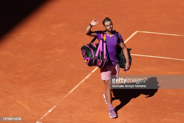 Rafael Nadal of Spain reacts following their Quarter Final loss against Alexander Zverev of Germany during Day Nine of the Mutua Madrid Open at La...