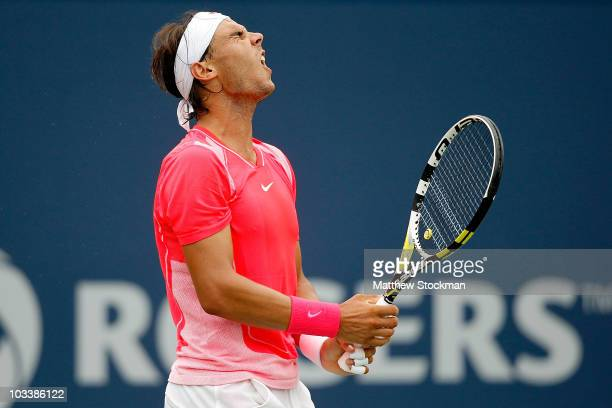 Rafael Nadal of Spain reacts to a lost point against Andy Murray of Great Britain during the semifinals of the Rogers Cup at the Rexall Centre on...